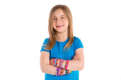Loom rubber bands bracelets blond kid girl Stock Photos