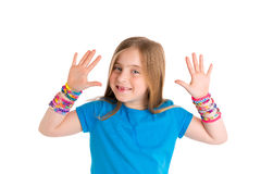 Loom rubber bands bracelets blond kid girl. Smiling open hands gesture on white background royalty free stock photography
