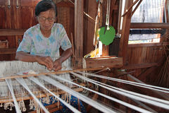 Loom in a silk workshop Stock Images