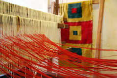 Weaving has been started on a loom Royalty Free Stock Photo