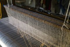 Weaving Loom. A loom used for weaving rugs and fabric from yarn Stock Photos