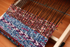 Loom and woven fabric, traditional pattern Royalty Free Stock Image