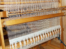 Loom with woven goods Stock Image
