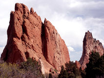 Looming Large. Lone climber about one-fourth of the way up at Garden of the Gods, Colorado Stock Image