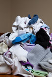 Looming Pile of Laundry. Pile of socks to be sorted and put away Royalty Free Stock Images
