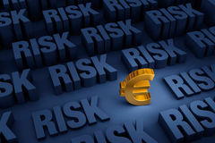 Looming Risk For The Euro. A small gold Euro sign stands out in a dark background of gray RISK rising up around it Stock Photo