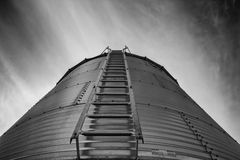 Looming steel grain bin Royalty Free Stock Image