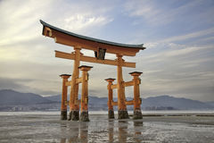 Looming vermilion tori (Shinto gate)Miyajima Island, Japan Royalty Free Stock Image
