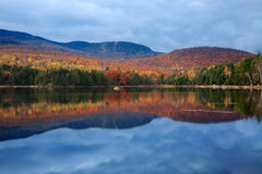 Loon Lake. A Clear Reflection On An Autumn Evening, Loon Lake, Adirondack Mountains, New York stock photo