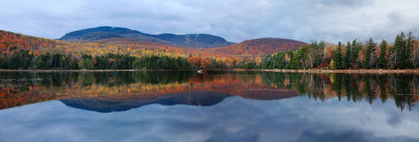 Loon Lake. A Clear Reflection On An Autumn Evening, Loon Lake, Adirondack Mountains, New York royalty free stock image