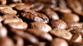 Loop able background of coffee beans. Rotating. Close up stock video