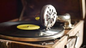 Loop-able Vintage Video of Old Gramophone, playing a record, close up slow motion. Shot stock video