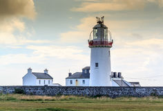 Loop Head Lighthouse. Loop Head, is a headland on the north side of the mouth of the River Shannon, in County Clare in the west of Ireland. Loop Head is marked Stock Photos