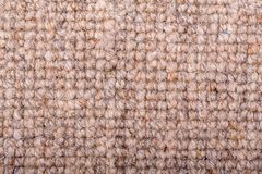 Loop pile wool carpet in beige. As close up of a loop pile wool carpet in neutral, beige and fawn tones stock photos