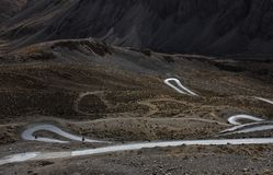 Loop roads with bikers in deep valleys of wilderness land of Ladakh, India stock photo