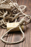 A loop of rope and soap on a background of wooden planks Stock Photos
