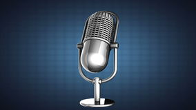Loop rotate Retro microphone on blue background Royalty Free Stock Photos