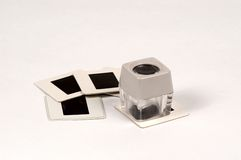 Loop with slides. Magnifying loop with mounted 35mm slides Royalty Free Stock Image