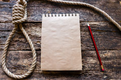 Loop for suicide. Notebook and a loop for suicide royalty free stock images