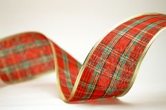 Loop of tartan Christmas ribbon. Abstract curve of colored Christmas ribbon Royalty Free Stock Photos