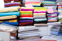 Loop towels in textile shop. The picture of loop towels in textile shop indoors stock photo