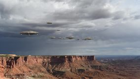 Loop with an UFO invasion over the Grand Canyon. Loop of alien spaceships flying above the Grand Canyon, in Canyonlands National Park, Utah, USA, for futuristic stock video footage