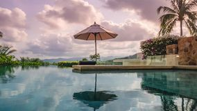 Loopable cinemagraph timelapse of swimming pool at luxury villa at sunset. Shot with a Sony a6300 fps 29,97 4k stock video footage