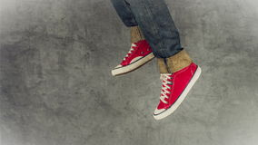 Loopable Stop Motion Animation of Young Person in Jeans and Red Sneakers Running stock video footage