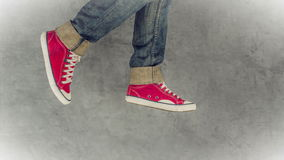 Loopable Stop Motion Animation of Young Person in Jeans and Red Sneakers Running stock footage