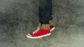 Loopable Stop Motion Animation of Young Person in Jeans and Red Sneakers Walking stock video footage