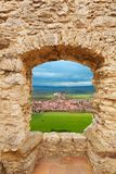 Loophole in castle and Spis hrad. Loophole of the castle and view of Spis hrad on the north of Slovakia stock photo