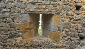 Loophole castle. Loophole into the stone walls of a medieval castle Royalty Free Stock Photography