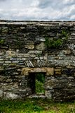 Loophole in the defensive wall. Of ancient Kamianets-Podilskyi Castle in Ukraine royalty free stock image