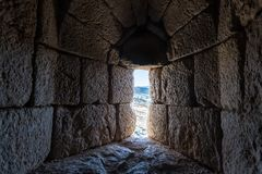Loophole on the lower tier in Nimrod Fortress located in Upper Galilee in northern Israel on the border with Lebanon. stock photos