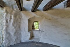 Loophole of medieval castle. Indoor Stock Images