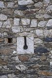 Loophole of a medieval castle. Stone wall. Spain stock image