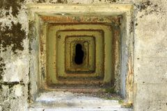 Loophole in an old military bunker. Loophole - machine-gun slit in an old military bunker royalty free stock photography