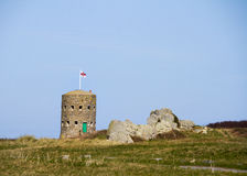 Loophole towers in Guernsey that guard the coastline. Stock Image
