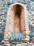 Loophole in wall of medieval castle. Fortification, for grunge look royalty free stock photo