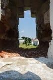 The loophole in the wall St. Nikolo-Tikhonov monastery. Village timirjazevo in the Ivanovo region Royalty Free Stock Photo