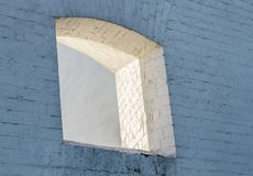 Loophole window in wall of old building. Loophole window in the wall of an old building royalty free stock image