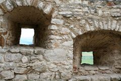 Loopholes. In a fortification in an ancient knight's castle in Slovakia Royalty Free Stock Image