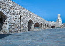Loopholes of the old fortress. Wall and battlements of the old fortress. Crete. Greece Stock Image
