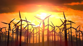 Looping animation of silhouettes of wind turbines at sunset.  stock footage