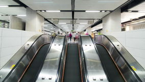 Looping anonymous crowd timelapse. Looping anonymous crowd timelapse in train station escalators. Wide shot stock footage