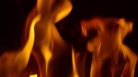 Looping background featuring orange flames flickering in slow motion stock footage