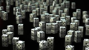 A Looping Pan Over Messy White Dice of a Reflective Surface stock footage