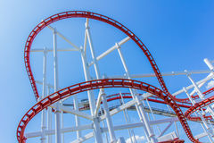 The loops of a scaring roller coaster. Royalty Free Stock Photos