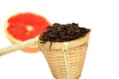 Loose black tea in a wattled basket Royalty Free Stock Photo