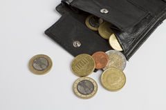 Loose cash falling out of black wallet Stock Image